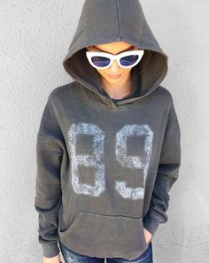 The Project Social T 89 graphic hoodie features a vintage athletic look and…