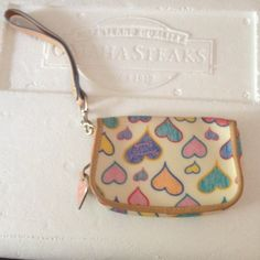 Authentic Dooney and Bourke wallet/cell holder Looks brand new! Comes with the strap, I will give discount if you want to buy purse too! :) NO TRADES Dooney & Bourke Bags Wallets