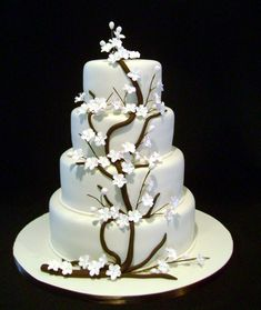 The wedding reception is all about the cake. Cake boss wedding cakes have become so elaborate, unique, and creative that you could walk into almost any bakery and hand the baker a sketch or picture… Cake Boss Wedding, Amazing Wedding Cakes, Amazing Cakes, Wedding Cakes With Cupcakes, Wedding Cakes With Flowers, Cupcake Cakes, Fondant Cakes, Cherry Blossom Cake, Cherry Blossom Wedding