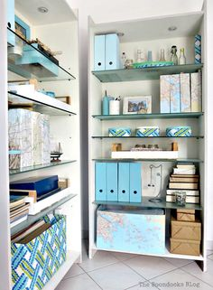 View of 2 bookcases in blue and maps look, Pretty and Practical Bookcases the Easy Way theboondocksblog.com