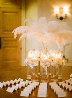 Feather Arrangement in Glass Vase | photography by http://www.esthersunphoto.com/