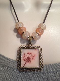 A personal favorite from my Etsy shop https://www.etsy.com/listing/235798731/vintage-pendant-tray-necklace-dandelion