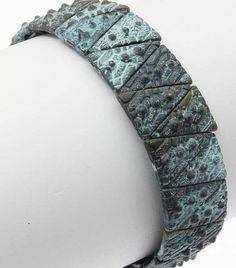 $16.56 BRACELET / AGED FINISH METAL / STRETCH / TEXTURED / 2 1/4 INCH DIAMETER / 3/4 INCH TALL / NICKEL AND LEAD COMPLIANT