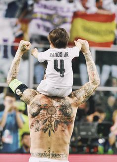 sergio ramos shows off his canvas of tattoos with his son perched onn his shoulders after real madrids ucl win Real Madrid Team, Ramos Real Madrid, Real Madrid Football Club, Real Madrid Players, Best Football Team, Football Soccer, Football Tattoo, Spain Football, Soccer Guys