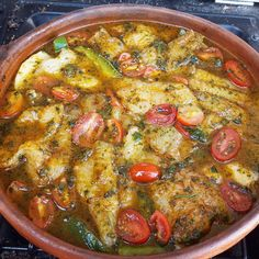 Moroccan #fish #tagine Cooked in a Tagra a non-glazed moroccan red clay #dish. A layer of sliced potatoes catfish sliced bellpepper and tomatoes. Seasoned with garlic parsley  cilantro cumin paprika salt and pepper. Slow cooked to perfection! #moroccanfood
