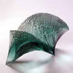 "One of the most famous glass artists in Japan, Ikuta Niyoko is known for her ethereal and geometric layered sculptures. Every piece Niyoko does is inspired by a feeling she wishes to convey. She explains, ""My motifs are derived from feelings of gentleness and harshness, fear, limitless expansion experienced through contact with nature, images from music, ethnic conflict, the heart affected by joy and anger, and prayer."""
