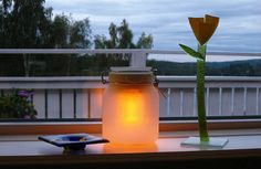Sun Jar made from the bits of a solar-powered garden light... these actually capture solar energy better than the store-bought plastic lanterns and glass magnifies both heat and light