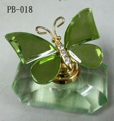 .Perfume bottle & butterfly & color green. This is a 3 in one winner.
