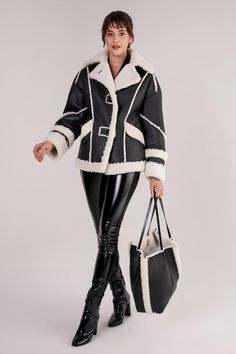 Striking design of shearling leather jacket featured with wool stripe details. Shawl, soft wool collar and wool end cuffs with stipe details. Double button closure with stripes design. Shearling Vest, Stripes Design, Curly, Leather Jacket, Black And White, Lady, Coat, Shawl, Model