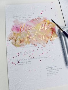 One of our all-time favorite invites! Featuring watercolor, gold foil, blind letterpress, luxe 2 ply cardstock... It has it all! #momentaldesigns #kristyrice #handpaintedinvite #watercolorwedding #goldfoil #blindletterpress