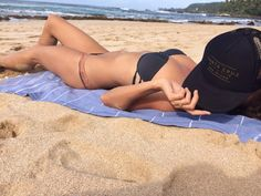 Our lovely Paige wearing our new trucker hat design in Hawaii!