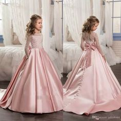 The unique flower girl dresses which match the flowers-long sleeve crystal flower girls dresses for weddings ball gown beaded sequins sweep train cheap pink girl communion dress is offered in julia4444 and on DHgate.com wedding flower girl dresses along with white communion shoes are on sale, too.