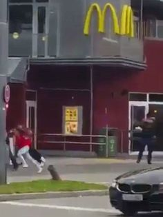 Gunman shouting 'Allahu Akbar' executed children in Munich McDonald's before rampaging through mall killing NINE with police now…