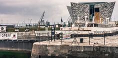 TITANIC BELFAST: Titanic Belfast is a visitor attraction and a monument to Belfast's maritime heritage on the site of the former Harland & Wolff shipyard in the city's Titanic Quarter.