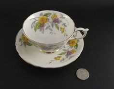 PARAGON Floral Antique Cabinet Tea Cup And Saucer 2Bl Stamp - CAD $89.71. Stunning footed white cup and saucer, with purple and yellow floral decals. No chips, cracks , crazing or damage unless noted. Please consider the pictures as part of the description and don't hesitate to ask questions! We try to ship most days around lunch time which means if you purchase in the morning it can go out the same day. We use and quote the lowest cost shipping method unless you request a faster arrival ...