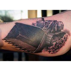 Heavy equipment tattoo, of a bulldozer, done by John Kautz