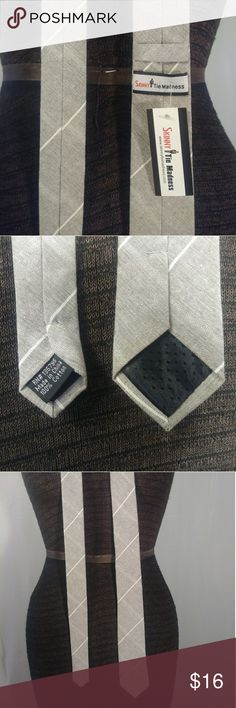 New Skinny Tie Madness Gray Career Necktie Casual New with tags, neck tie by Skinny Tie Madness. Light gray with white diagonal stripes. Obviously, this is a skinny design & normal length. 100% cotton. RN# 135795  Offers always welcome! Expedited shipping & free gift wrapping available upon request. Skinny Tie Madness Accessories Ties