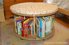 Diary of a Crafty Lady: Wooden Spool Rolling Bookshelf and Stool  Another take on the spool stool/bookshelf.