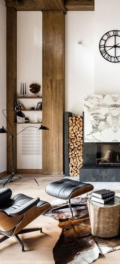 An extremely minimalist approach to a modern rustic living room. Although I feel this image is a conceptual idealization of elements that would work well in this space, I find it compelling. I love the contrast between the warm honey tones of the wood with the details in black. It's dramatic, striking and has a sophisticated vibe. #livingroomideas #livingrooms #modernrusticlivingroom #rusticlivingroom #cabins #decoratingideas