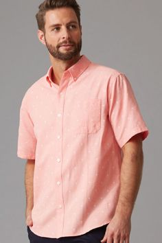 Cut in our classic fit in a lightweight yarn dyed cotton this shirt features an all over palm tree print. With a button down collar, and a box pleat cut into the back for added comfort this shirt is available in both sky blue and coral.