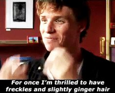 eddie redmayne - for once he is thrilled to have freckles and slightly ginger hair