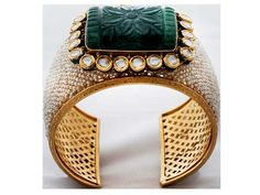 Ancient mysteryA traditional, yellow gold cuff by Falguni Mehta makes an endearing appeal with its choice of precious stones and design, asdiamonds, pearls and emerald dazzle in full glory.