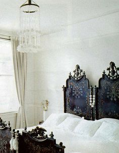 White bedroom with vintage headboard--those beds!