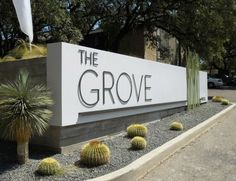 Apartment/Subdivision Signage light grey concrete modern industrial plain with cactus & palm plant nice low maintenance: