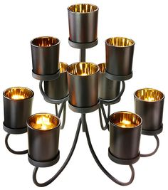 Artikeldetails:  Mehrarmiger Kerzenständer, Mit Teelichthaltern,  Maße:  Maße (B/T/H): 30/30/31 cm,  Material/Qualität:  Aus Metall und Glas,  Wissenswertes:  Lieferung ohne Kerzen.,  ...