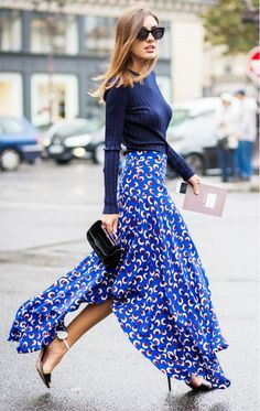 A simple sweater and a bold maxi skirt can go a long way by transitioning your look from day to night. #Streetstyle