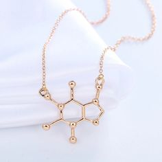 A personal favorite from Jewel Empire https://www.jewelempire.us/collections/new-arrivals-2016/products/caffeine-molecule-pendant-necklace-gold