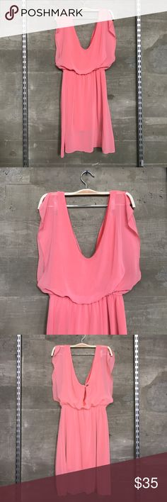 Brandy Melville • pink flowy dress Brandy Melville • made in Italy • pink twirly dress • waterfall sleeves • deep sides • deep v in the front and back with an extra cutout in the back with button detail • lined with a super soft fabric Brandy Melville Dresses