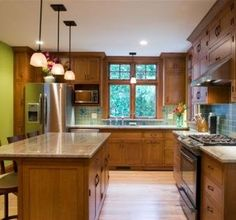 Love the cabinets and the window above the sink.