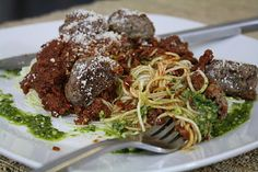 Looks yummy!!! Raw zucchini noodles and sun dried tomato sauce with cooked moose meat balls, raw pesto drizzle, and raw parmesan