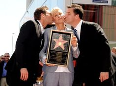 Ellen DeGeneres getting kisses from Jimmy Kimmel and Ryan Seacrest.