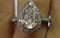 Rose gold pear shape engagement ring