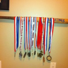 Unique Way To Hang Sports Pennants Use A Curtain Rod And