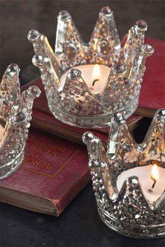These crown-shaped candleholders have a mercury glass finish to give them a worn texture that allows light to festively glimmer through. Perfect for holiday decorating, these crown votives would look