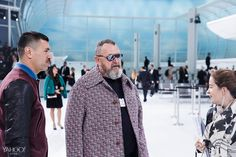 Michel Gaubert (with Ryan Aguilar) checking on last-minute details before show. Photography by Cyrille George Jerusalmi for Yahoo Style.