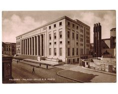This vintage postcard, circa 1930s, features the Palazzo Delle Poste (Post Office Building) in Palermo, Sicily, Italy. The building was constructed between 1928 and 1934 in the Italian fascist architectural style.