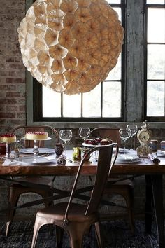 Rhododendron Chandelier  from anthropologie  (Paper, metal, tyvek) http://www.anthropologie.com/anthro/catalog/productdetail.jsp?id=20504387&catId=HOME-LIGHTING&pushId=HOME-LIGHTING&popId=HOME&navCount=42&color=000&isProduct=true&fromCategoryPage=true&isSubcategory=true&subCategoryId=HOME-LIGHTING-CHANDELIERS