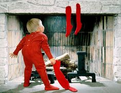 Child looking up the chimney for Santa Toni Kami  Joyeux Noël  Darling Christmas photography idea for girl or boy red PJ's