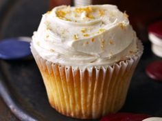 Whiskey-soaked orange cupcakes topped with Old-Fashioned buttercream?  All you need is a maraschino cherry on top to complete these cocktail inspired cupcakes.