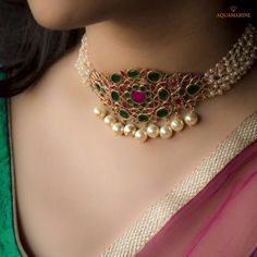Magnicent and brilliant, this pearl choker necklace in bold green and pink with gold pearls at the bottom looks ethnic and royal. Available at Aquamarine.  #aquamarine_jewellery #chokernecklace #goldpearls #green #pink #bold #designerjewellery #weddingjewellery #indianjewellery #mumbai #india #aquamarinejewellery