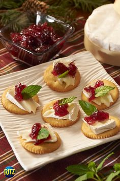 Ritz crackers topped with cranberry and Brie cheese to get you in the festive mood.  Ingredients 48 RITZ Crackers 6 oz. Brie cheese, cut into 48 pieces 1/4 cup whole berry cranberry sauce 48 small fresh mint leaves Instructions Top crackers with remaining ingredients.