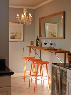 With no room for a table in her own small kitchen, interior designer Melanie Coddington installed a pine slab counter in an adjacent alcove. The barstools are actually school-laboratory seats that Coddington sanded and spray-painted orange. A mirror over the bar reflects a pretty view of trees outside a sunny window, keeping the tight space from feeling claustrophobic.