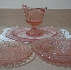 """Assorted Pink Glassware: Princess Salad Plate, 8½"""". Holiday Saucer, 5½"""". American  Cereal Bowl, 6"""". Fairfax Creamer, 4"""" tall. No mfg name given. $40.00/4-pcs at Lalecreations on etsy, 3/30/16"""