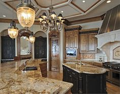 Waaaay too expensive, but I like how they mixed the light and dark wood cabinets. LOVE the countertop color Old World Kitchens, Luxury Kitchens, Cool Kitchens, Dream Kitchens, Kim House, Welcome To My House, New Homes, Texas Homes, Best Kitchen Designs