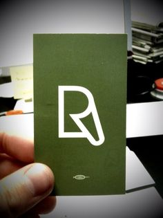 Clever logo - Recycled paper printing. Just in case you don't see it - its a piece of paper curled at the corner to form an R :)