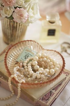 Pearls in a dish on your dressing table vanity.